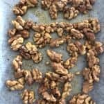 Roasted walnuts with olive oil and salted peper on a baking paper.