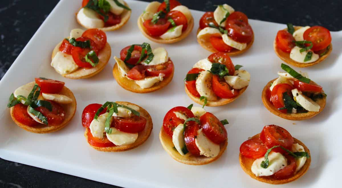 Tartlets on a white platter.