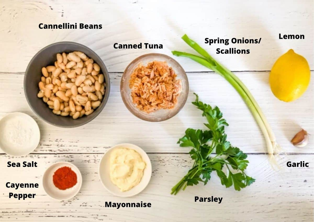 ingredients in tuna and white bean dip on a white background.