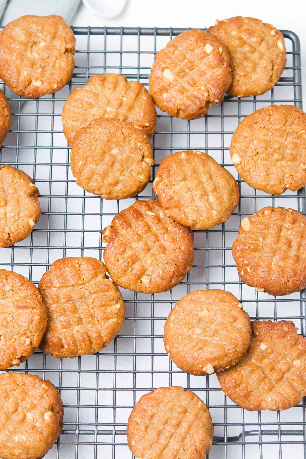 cookies spread out on a cooling rack.