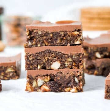 three tiffin pieces stacked, with other pieces surrounding and in the background.