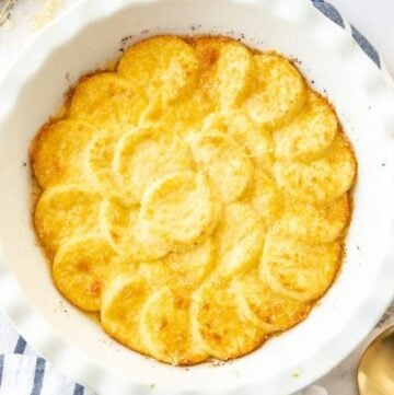 dish of baked gnocchi sitting on a striped cloth.