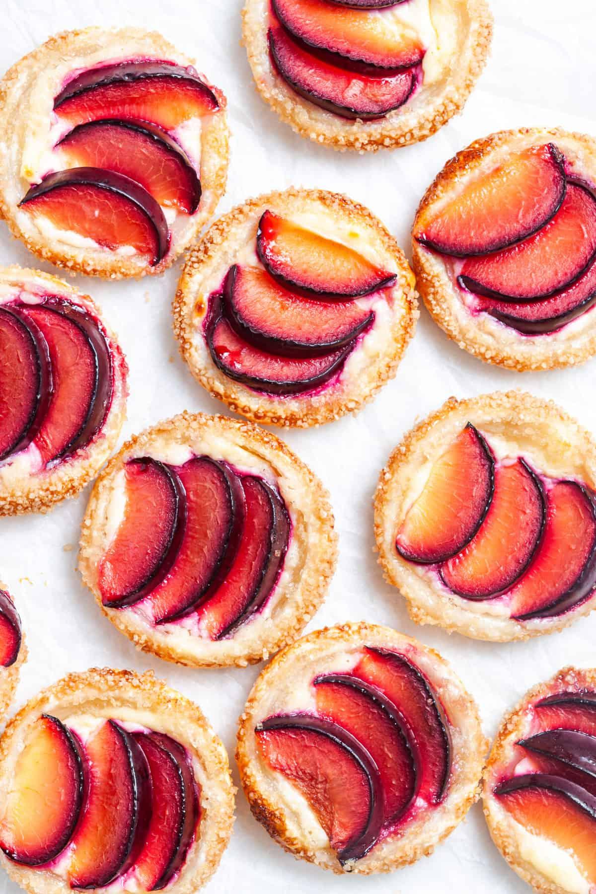 up close shot of tarts on baking paper.
