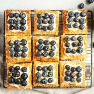 9 tartlets assembled and sitting on a cooling tray.