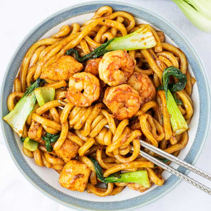 Bowl of Garlic Udon noodles with chopsticks.