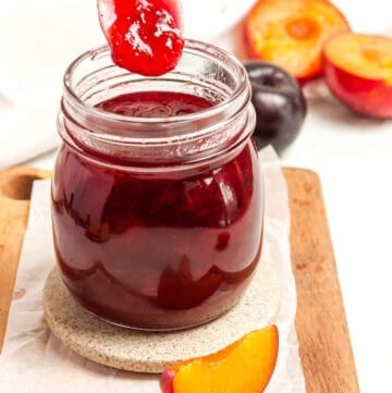 Spoon dipping into a jar of jam.