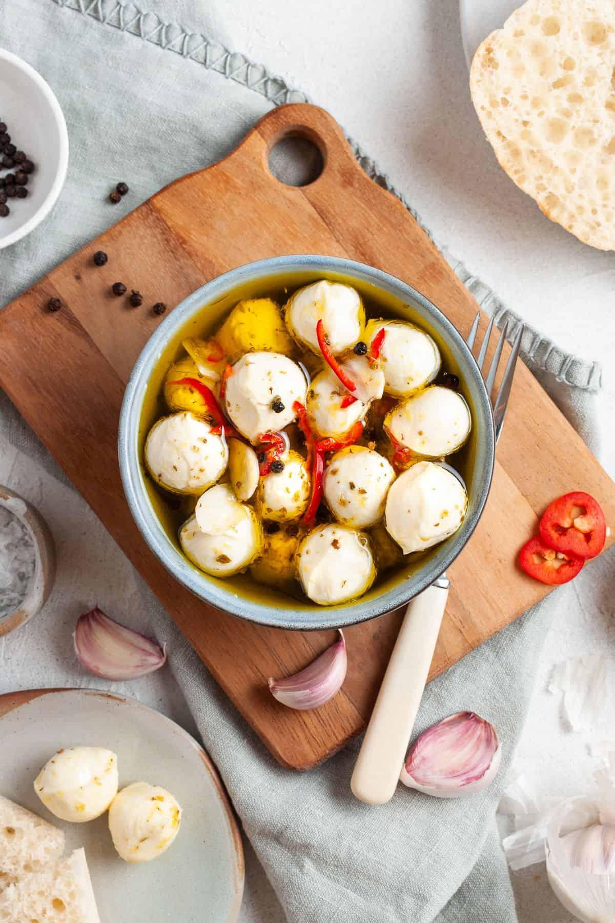 Overhead shot of bowl of mozzarella balls ready to serve.