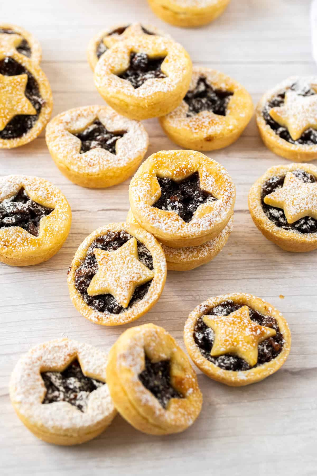 Overhead shot of mince pies sitting on a bench.